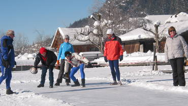 Curling on the alpine ice
